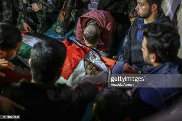 People mourn during the funeral ceremony of Muhammed Nebii Muhaysin who was martyred during the clashes between Palestinian protesters and Israeli...