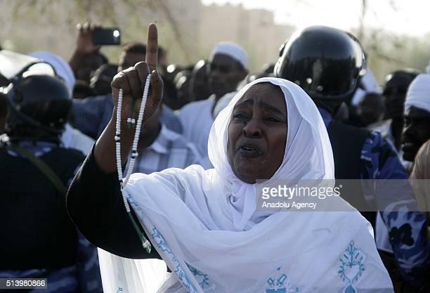 People mourn during the funeral of Veteran Sudan Islamist opposition leader who formed the Popular Congress Party Hassan alTurabi in Khartoum Sudan...
