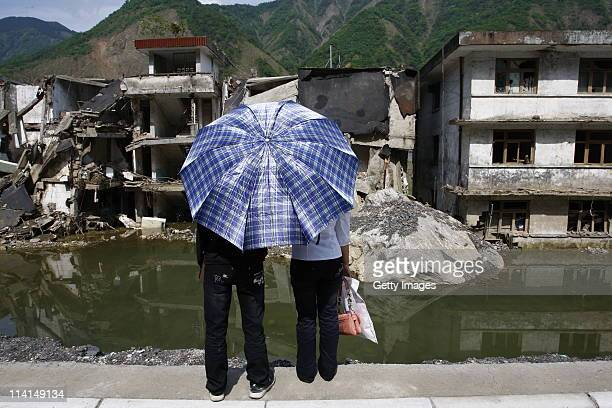 People mourn for fellow countrymen lost in the 2008 Sichuan earthquake on the third anniversary on May 12 2011 in Wenchuan Sichuan Province of China...