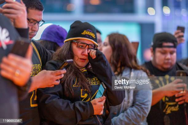 People mourn for former NBA star Kobe Bryant, who was killed in a helicopter crash in Calabasas, California, near Staples Center on January 26, 2020...