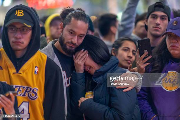 People mourn for former NBA star Kobe Bryant who was killed in a helicopter crash in Calabasas California near Staples Center on January 26 2020 in...