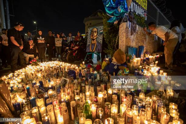 People mourn for rapper Nipsey Hussle on April 1 2019 in Los Angeles California The Grammynominated artist was gunned down in broad daylight in front...