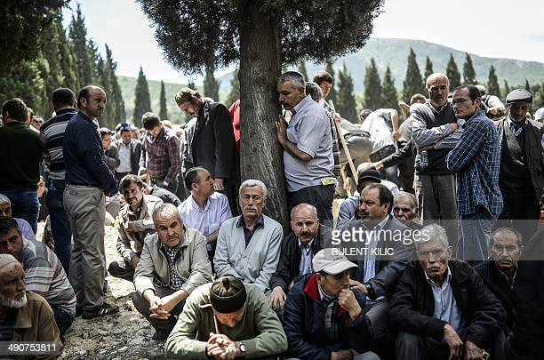 People mourn in a cemetery during the funeral ceremony of miners who died in an explosion on May 15 in the western town of Soma in the Manisa...