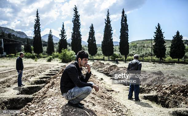 People mourn in a graveyard on May 16, 2014 in the western town of Soma after an explosion and a fire in a coal mine killed at least 284 workers...