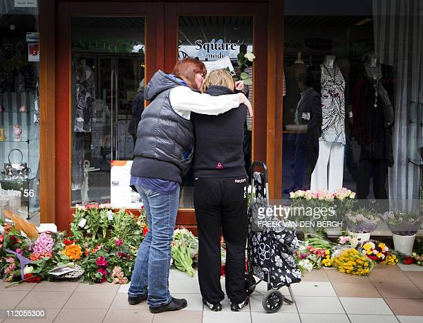 People mourn in front of a clothing shop in the 'De Ridderhof' shopping mall in Alphen aan den Rijn, on April 12, 2011 where a 24-year-old Tristan...