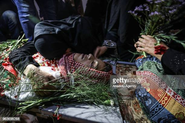 People mourn over the body of Naci Guneyim who was killed after Israeli soldiers opened fire during Great March of Return demonstration during a...