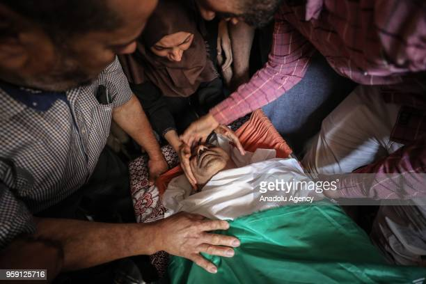 People mourn over the dead body of Nasir Ahmed Garrab who lost his life after Israeli soldiers opened fire on protest held to mark 70th anniversary...
