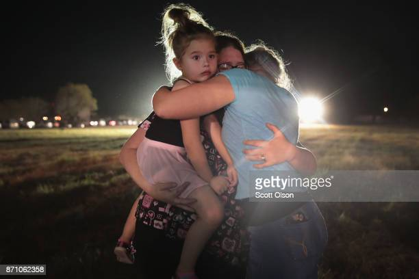 People mourn the 26 victims killed at the First Baptist Church of Sutherland Springs during a prayer service on November 6 2017 in Sutherland Springs...