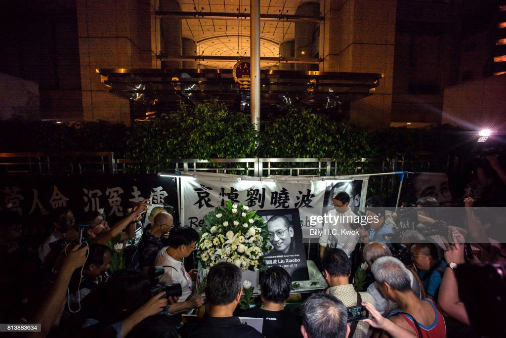 People mourn the death of jailed Chinese Nobel Peace laureate Liu Xiaobo during a demonstration outside the Chinese liaison office on July 13, 2017 in Hong Kong, Hong Kong. Liu Xiaobo, a Nobel Peace Prize-winning Chinese dissident, died of multiple organ failure at 61 while in Chinese custody, local authorities said in a statement on Thursday. The Chinese intellectual and activist was jailed for 11 years in 2009 for 'inciting subversion of state power' but moved to a hospital in May because he was suffering advanced-stage liver cancer.