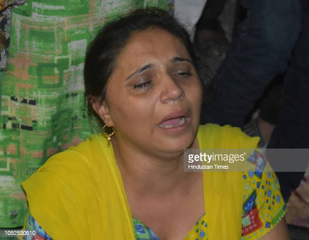 People mourn the demise of their relatives due to a train accident on October 19 2018 in Amritsar India Several people were killed after a train ran...