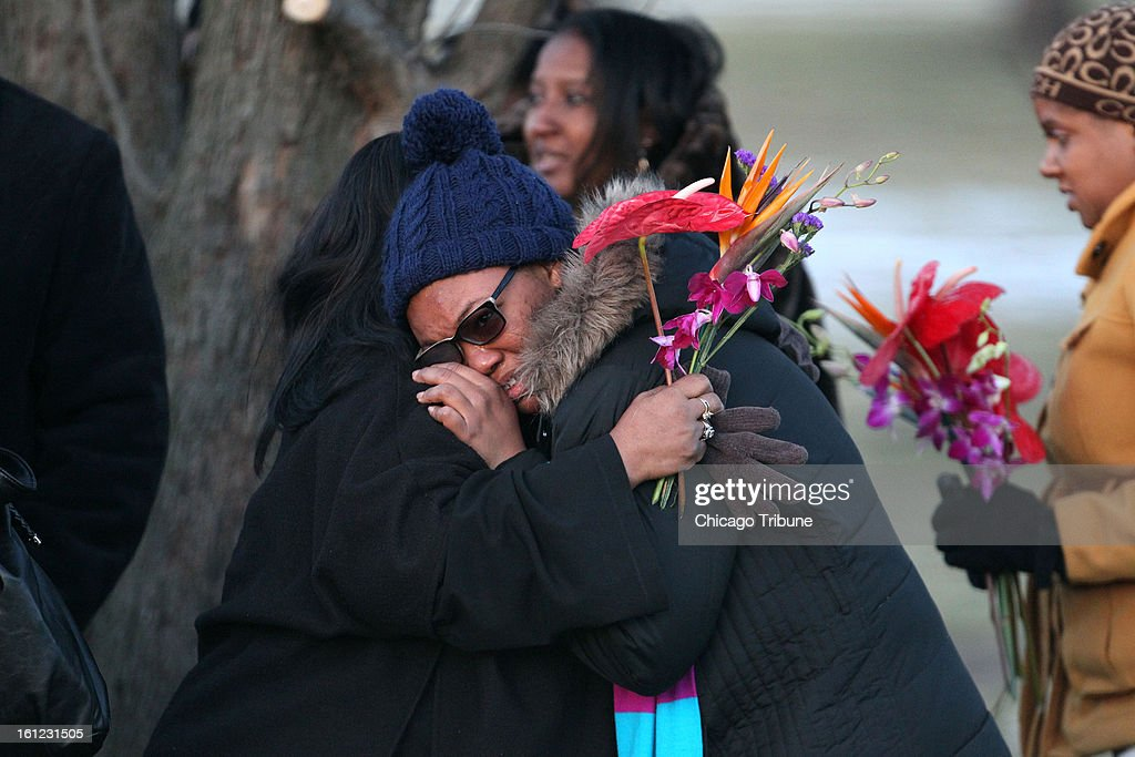 People mourn the loss of Hadiya Pendleton as the 15-year-old is laid to rest at Cedar Park Cemetery in Riverdale, Illinois, on Saturday, February 9, 2013.