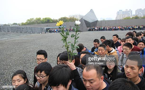 People mourn the victims at Memorial Hall of the Victims in Nanjing Massacre by Japanese Invaders on Qingming Festival on April 5 2015 in Nanjing...