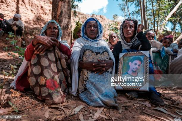People mourn the victims of a massacre allegedly perpetrated by Eritrean Soldiers in the village of Dengolat, North of Mekele, the capital of Tigray...