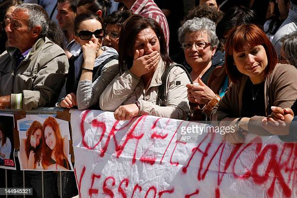 People mourns Melissa Bassi during her funeral on May 21, 2012 in Mesagne. Italian authorities searched the same day for a suspect caught on...
