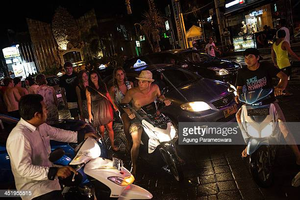 People move through a traffic jam on Poppies Line II Street during Australian 'schoolies' celebrations following the end of the year 12 exams on...