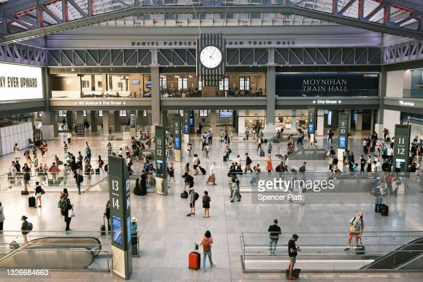 People move through the Moynihan Train Hall at Penn Station before the start of the Fourth of July weekend on July 02, 2021 in New York City....