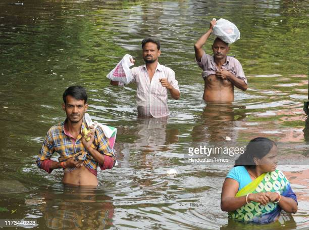 People move to safety on the sixth day of water logging after heavy rain at Rajendra Nagar on October 3 2019 in Patna India The state has been...