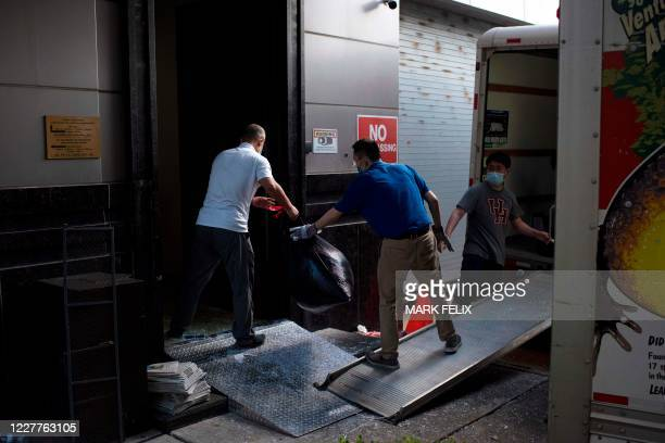 People move trash bags from the Chinese consulate in Houston on July 24 after the US State Department ordered China to close the consulate. - The US...