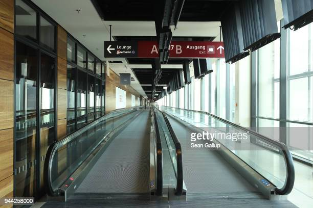 People movers stand inside the South Pier terminal at the BER Willy Brandt Berlin Brandenburg International Airport on April 10 2018 in Schoenefeld...