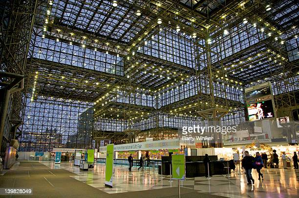 people moving inside crystal palace, 150-foot high lobby of jacob k. javits convention center, midtown west, new york, n.y., usa - tradeshow stock pictures, royalty-free photos & images