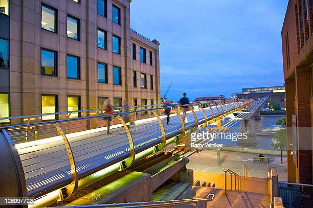 people moving swiftly across millenium bridge over the river thames, london, united kingdom - 2000 2009 stock pictures, royalty-free photos & images