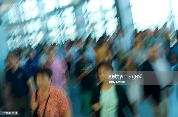 people moving through terminal