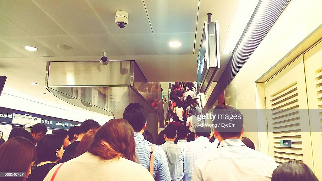 People Moving Up In Subway Toward Staircase : Stock Photo