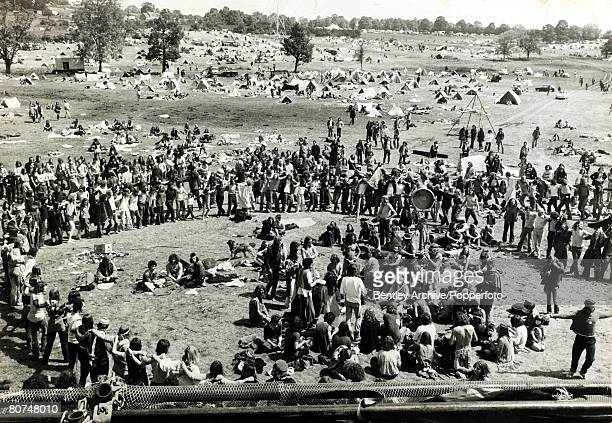23rd June 1971England Some of the 10000 young people near the improvised campsite at the Glastonbury Pop Festival form a circle for a 'hippie' style...
