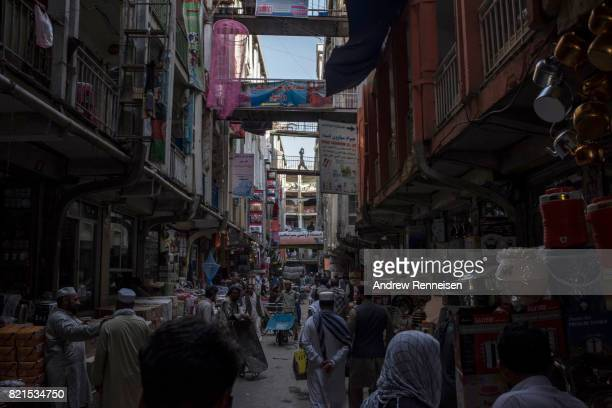 People navigate a busy street in the bazaar in Kabul's old city neighborhood on July 20 2017 in Kabul AfghanistanDespite a heavy security presence...