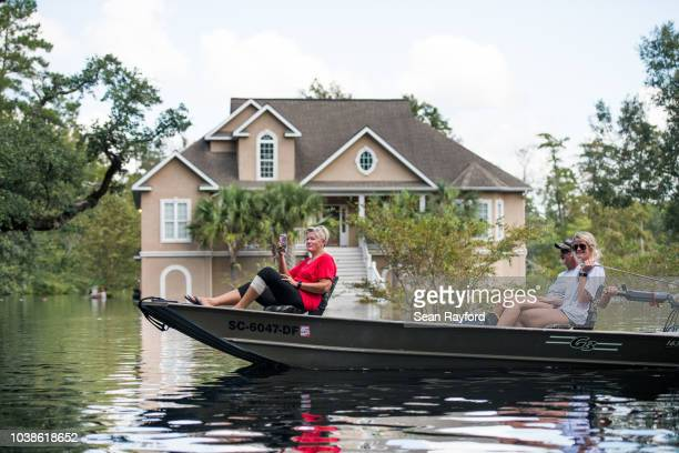 People navigate floodwaters caused by Hurricane Florence near the Waccamaw River on September 23 2018 in Conway South Carolina Floodwaters are...