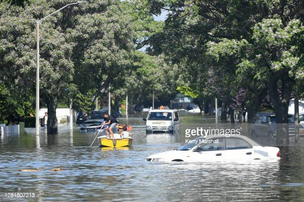 People navigate streets in a boat following the second highest amount of rainfall ever recorded in the city on November 10, 2020 in Napier, New...