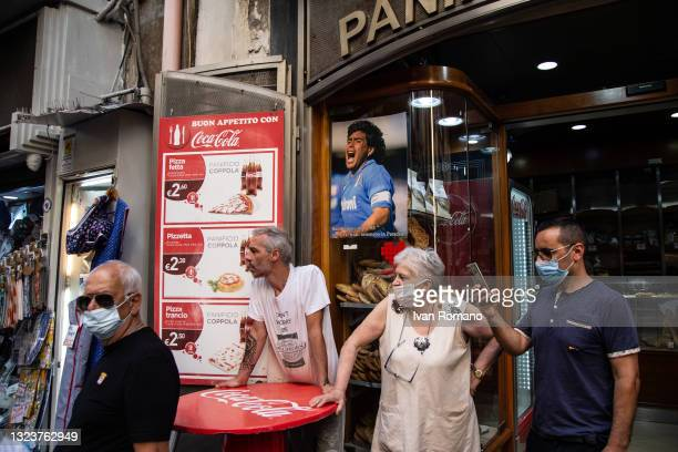 People near a bakery during Giuseppe Conte's visit to Pignasecca flea market on June 15, 2021 in Naples, Italy. The political head of the 5 Star...