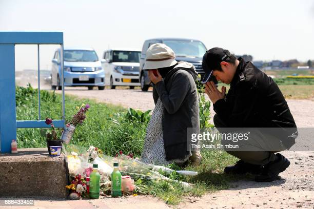 People near the area where the body of a 9-year-old Vietnamese girl Le Thi Nhat Linh was found after suspect Yasumasa Shibuya was arrested on April...
