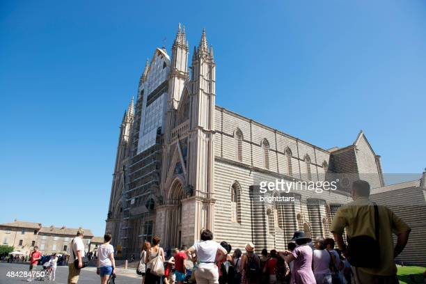 people nearby orvieto cathedral, italy - orvieto stock pictures, royalty-free photos & images