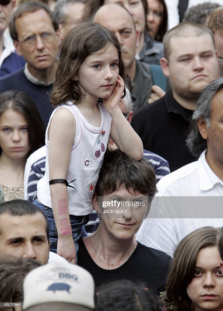 People observe a minute of silence 09 July 2005 to remember the victims of the London bombings that killed at least 50 people and injured some 700.