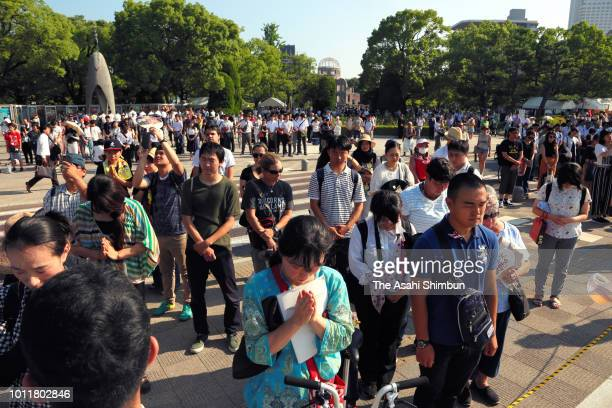 People observe a minute of silence for the ABomb victims during the Peace Memorial Ceremony at the Hiroshima Peace Memorial Park on 73rd anniversary...