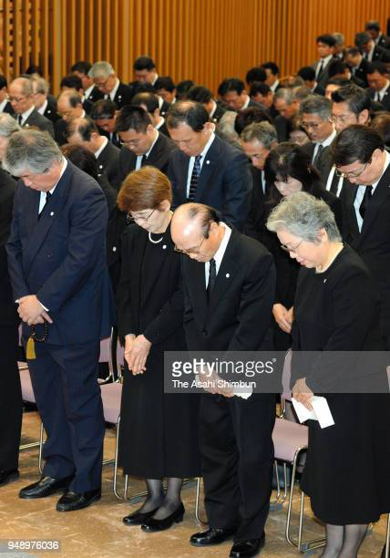 People observe a minute of silence for the victims during the memorial ceremony on the second anniversary of the Kumamoto Earthquakes on April 14...