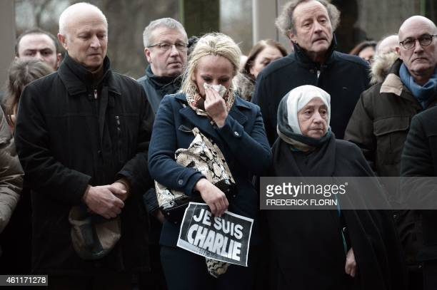 People observe a minute of silence in Strasbourg, eastern France on January 8, 2015 for the victims of an attack by armed gunmen on the offices of...