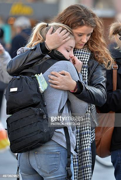 People observe a minute of silence on November 16 2015 at the central square of Strasbourg eastern France to pay tribute to victims of the attacks in...