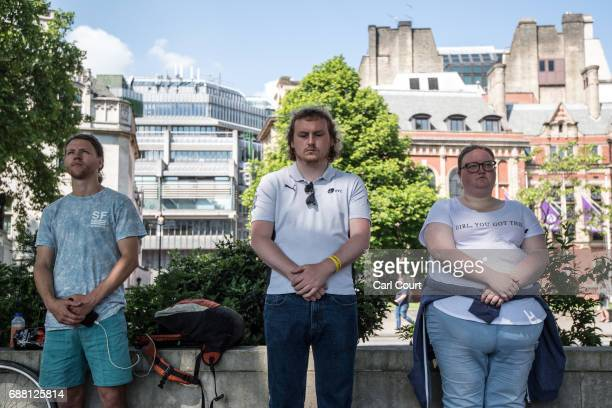 People observe a minute silence in memory of the victims of the Manchester attack on May 25 2017 in Parliament Square London England People around...