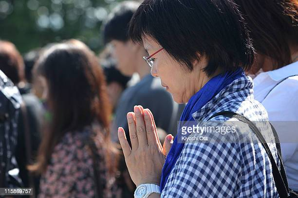 People observe a moment of silence at 1446 the same time of the earthquake that occurred on March 11 on June 11 2011 in Minamisanriku Miyagi Japan...