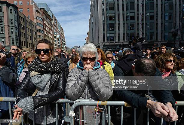 People observe a moment of silence near the Boston Marathon finish line on one week anniversary of the bombings on April 22 2013 in Boston...