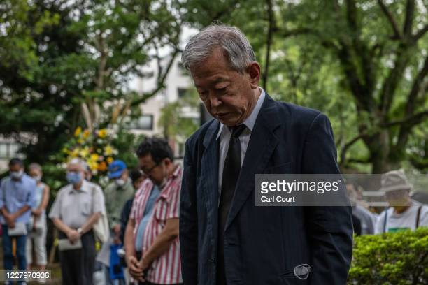 People observe a one minute silence during a remembrance service for Korean victims of the atomic bomb on the 75th anniversary of the Nagasaki atomic...
