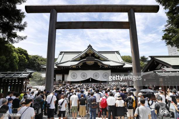 People observe a silent prayer at the Yasukuni Shrine in Tokyo on Aug 15 the 73rd anniversary of Japan's surrender in World War II The shrine honors...