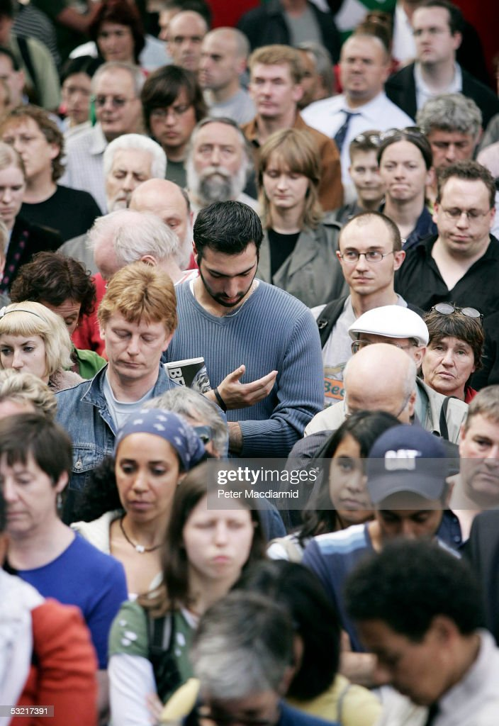 People observe a two minutes silence in memory of the victims of the London bombings at a vigil on July 9, 2005 London. A massive police investigation is underway to track down the bombers after 49 people were killed and 700 injured during morning rush hour terrorist attacks on July 7.