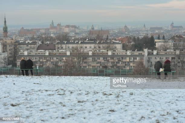People observe Krakow's Old Town from Krakus Mound On Saturday 30 December 2017 in Krakow Poland