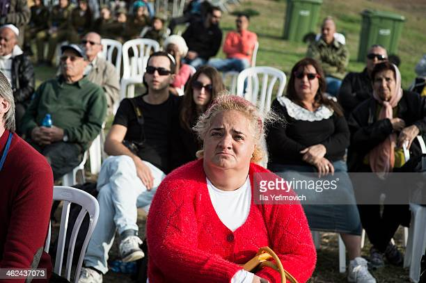 People observe the burial ceremony for Israel's former Prime Minister Ariel Sharon at Havat Hashikmim on January 13 2014 in Israel Former PM Ariel...