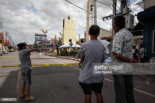 People observe the site of an explosion on Friday August 12 2016 in Hua Hin Thailand A series of coordinated blasts across Southern Thailand...
