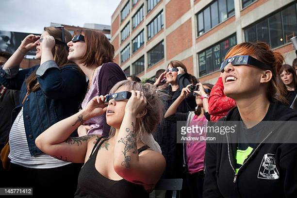 People observe the Transit of Venus from the High Line park on June 5 2012 in New York City The Transit of Venus involves the planet Venus crossing...