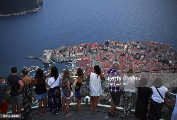 TOPSHOT People observe the walled Old Town of Dubrovnik in Croatia on September 1 2018